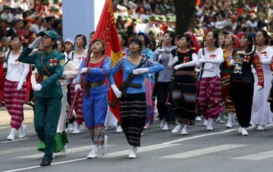 Female members of the ethnic minorities militia force march during a military parade as part of the 40th anniversary of the fall of Saigon in Ho Chi Minh City (formerly Saigon), Vietnam